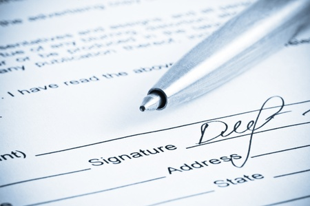 legal document: Signature. Close-up of a pen. Stock Photo