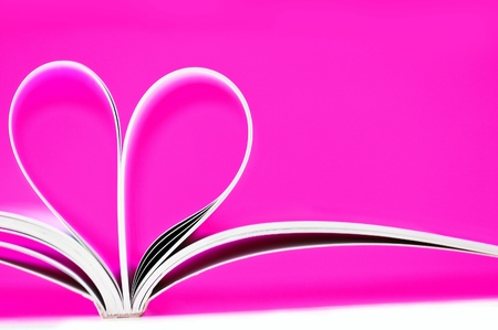 pages of a book curved into a heart shape photo