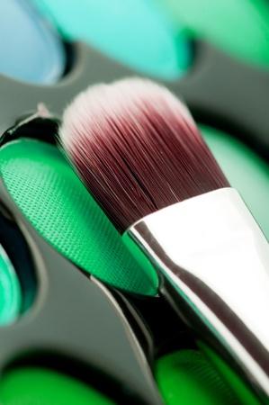 eyemakeup: multicolored eye shadows with cosmetics brush  Stock Photo