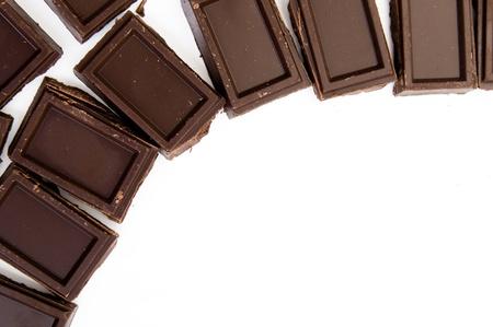 Chocolate pieces on white  photo