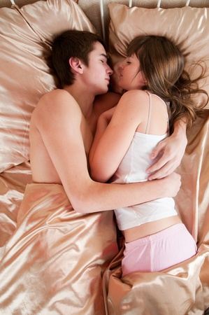 Young couple sleeping in a bed Stock Photo - 9303926