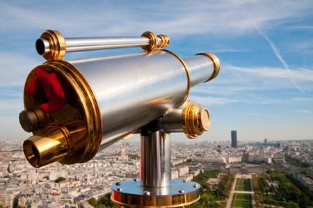 Eiffel Tower telescope overlooking for Paris. photo