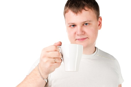 Isolated Young man drinking a cup Stock Photo - 9494946