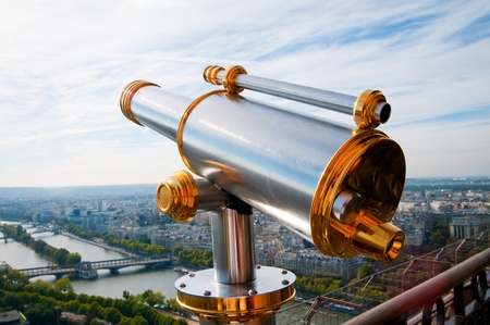 Eiffel Tower telescope overlooking for Paris. photo