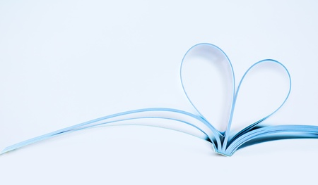 composition book: Pages of magazine curved into a heart shape