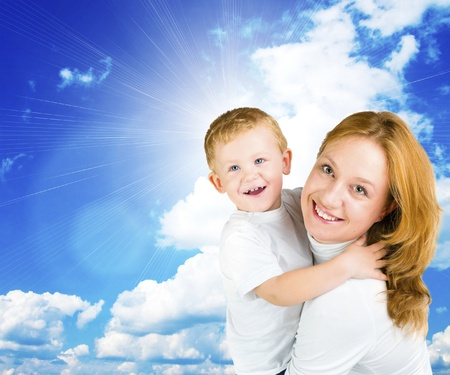 Woman and little boy against blue summer sky  photo