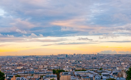 Paris skyline from the Sacre Coeur at a summer sunset.  photo