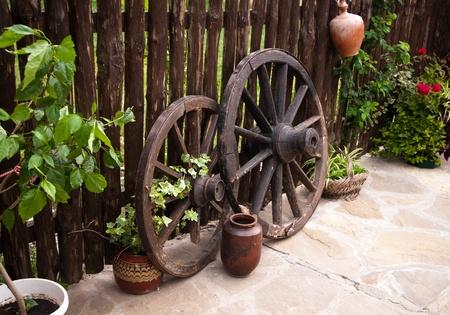 old wood coach wheel around barn. Bulgaria photo
