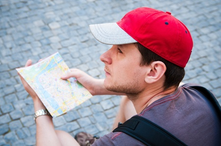 Tourists on the street looking at a guide  photo