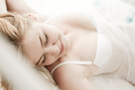 sexy blond woman sleep on bed in lingerie