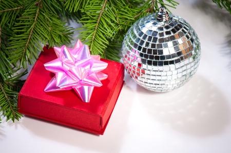 gift, disco ball and green christmas tree  photo