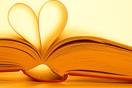 pages of book curved into heart shape  photo