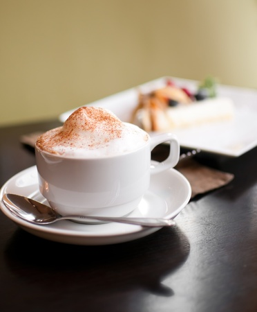 A cappuccino cup with milk foam and cinnamon photo
