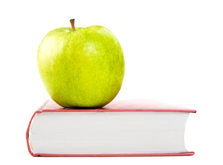 A green apple on a book  photo