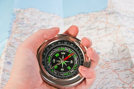 compass in the hand,map in the background  Stock Photo - 11711545