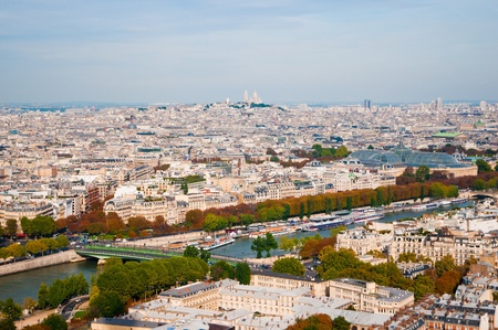 Aerial panoramic view of Paris and Seine river as seen from Eiffel Tower in Paris, France.  photo