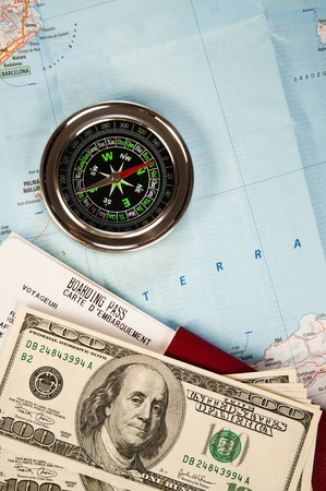 compass, money and passport with boarding pass photo