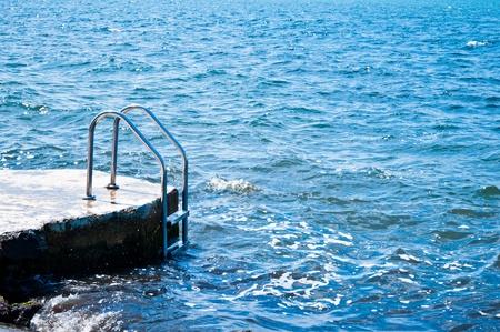 Ocean stair swimming photo