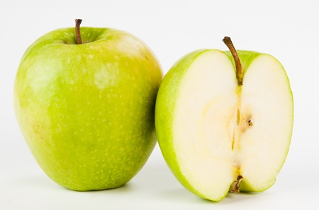 Green apples and half of apple Isolated on a white background  Stock Photo - 12913093