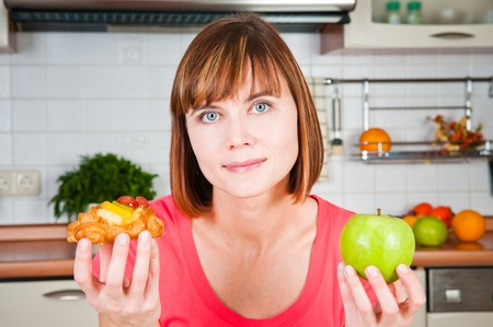 Young woman chooses healthy diet  Stock Photo - 12912724