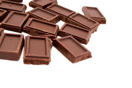 chocolate bars on white background photo