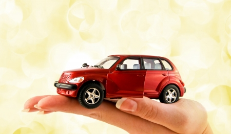 Red car in hand photo