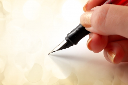 Close-up of a fountain pen with lights in the background  photo