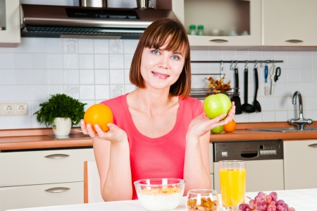 beautiful woman holding a green apple and orange photo
