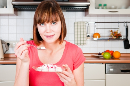 Beautiful woman having a healthy breakfast  photo