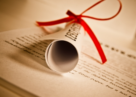 business degree: Diploma with red ribbon  Stock Photo