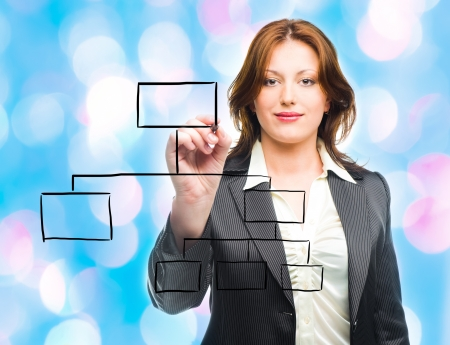 Business woman designing a plan on screen  with blue lights in the background  photo