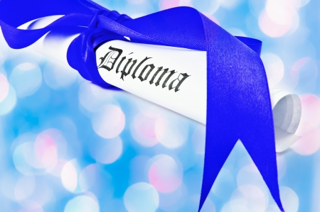 Diploma with blue ribbon with blue lights in the background  photo