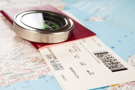compass and passport with boarding pass photo