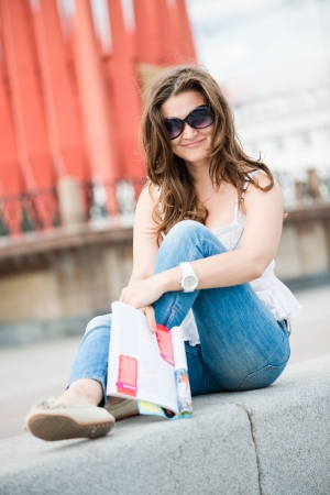 Outdoor portrait of young woman with fashion magazine Stock Photo - 14608740