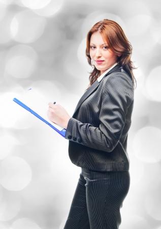 business woman holding a portfolio  photo
