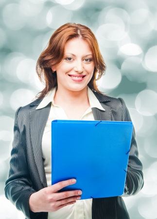 business woman holding a portfolio photo