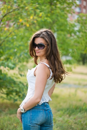Portrait of a beautiful european woman smiling outdoors  photo