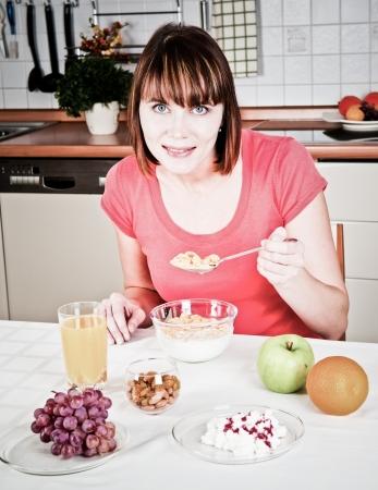 Beautiful woman having a healthy breakfast  photo