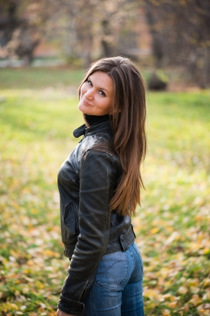 young woman portrait in autumn park  photo