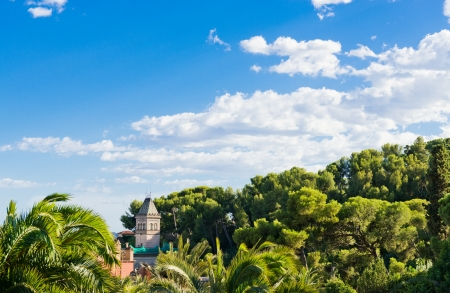 distant spot: Gaudis house with tower in Park Guell, Barcelona
