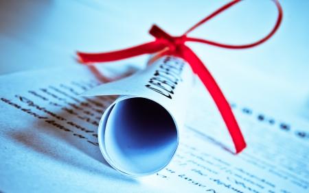 Diploma with red ribbon  photo
