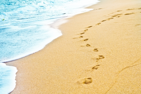 footprints in the sand: Footprint on sand with foam  Stock Photo