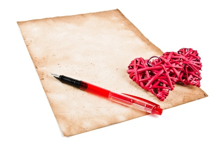 Red straw hearts on old paper