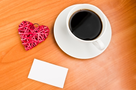 Red straw heart and cup of coffee photo