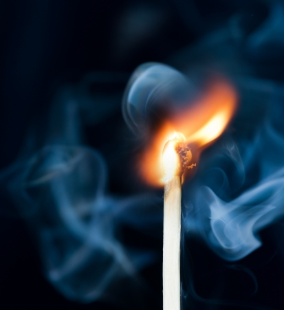 Ignition of match with smoke, isolated on black background Stock Photo - 17354917