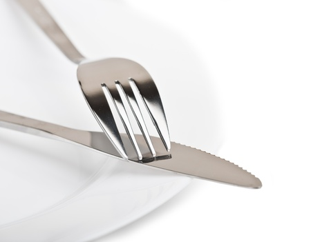 knife and fork on white plate Stock Photo - 17668800