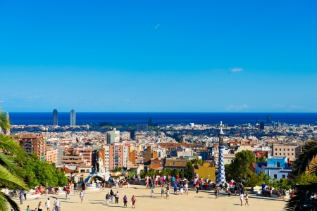 BARCELONA, SPAIN - SEPTEMBER 13: People visit the Park Guell in September 13, 2012 in Barcelona, Spain.  Park Guell is the famous park designed by Antoni Gaudi and built in the years 1900 to 1914