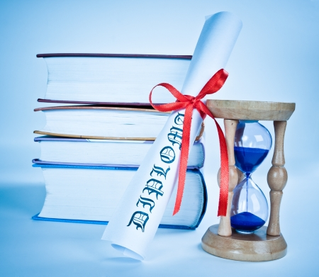 baccalaureate: Diploma and books and hourglass