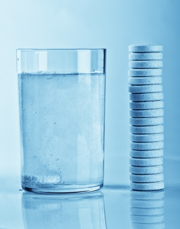 fizzy tablet: Fizzy tablet in a glass of water and stack of tablets