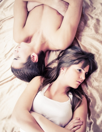angry woman: Upset couple sleeping separately on their bed  Stock Photo